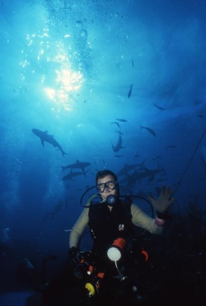 Brad with blacktip reef sharks behind-Exumas