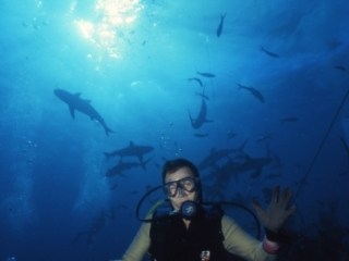 Brad with blacktip reef sharks behind-Exumas