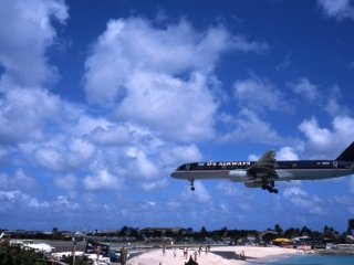 Jet landing over beach-St. Maarten