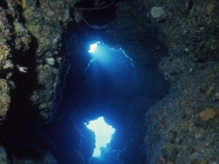 Scenic of cave with sunlight-Little Cayman